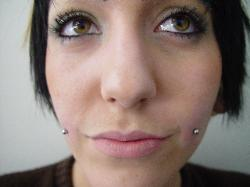 Picture of Cheek Dimple Piercings. Mystical Body Piercing Shop Modesto, CA
