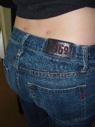 Dermals on the lower back dimples. Microdermals picture. Mystical Body Piercing